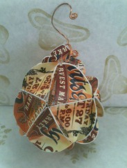 Ornament by Joanne Sadoski made of Harvest Market postcards
